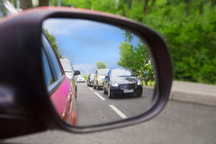 Reflection in an automobile mirror Royalty Free Stock Image