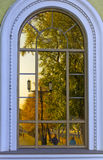 Reflection of the  autumn of the city in antique window Stock Photography