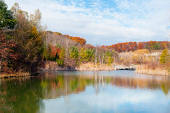 Reflection of autumn hiking route in pond Stock Photo
