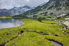 Reflection of Banderishki chukar peak in Muratovo lake, Pirin Mountain Stock Images