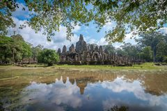 Reflection of Bayon castle in Siem Reap, Cambodia. View of the reflection of Bayon castle in Siem Reap, Cambodia royalty free stock images