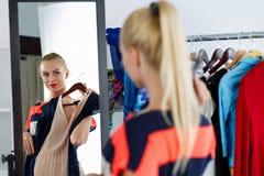 Reflection of beautiful blonde woman Stock Photo