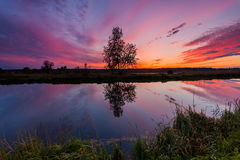 Reflection of a beautiful dawn sky in a river Stock Photo