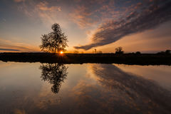 Reflection of a beautiful dawn sky in a river royalty free stock image