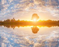 Reflection of a beautiful dawn sky in a river Stock Photos