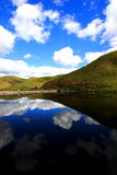 Reflection. Beautiful lake in Oudshoorn South Africa where the blue sky and clouds are reflected in the lake Stock Photos