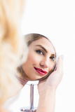 Reflection of beautiful woman in hand mirror Royalty Free Stock Photography