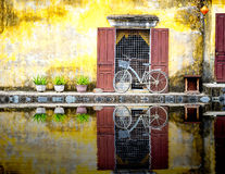 A reflection of a bicycle in hoi-an. A reflection of a bicycle in the canal by the old japanese bridge in hoi-an,vietnam Stock Images