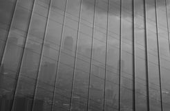 Reflection of big city in metal wall of office building, black a Royalty Free Stock Image