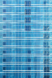 Reflection in blue glass wall of an modern office building Stock Image