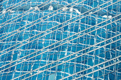 Reflection in blue glass wall of an modern office building Stock Images