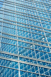 Reflection in blue glass wall of an modern office building Royalty Free Stock Photo
