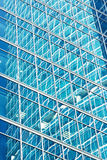 Reflection in blue glass wall of an modern office building Royalty Free Stock Images