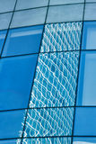 Reflection in blue glass wall of modern office building Royalty Free Stock Image