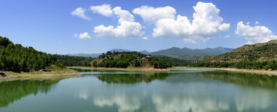 The reflection of the blue sky, white clouds, mountains and lakes in Qinghai province of China. The blue sky, white clouds, the lake and the mountains in Qinghai Royalty Free Stock Photography