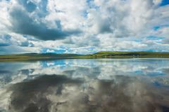 Reflection of blue sky with white clouds in water. Place for text. Reflection of blue sky with white clouds in water royalty free stock image