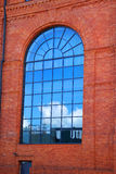 Reflection of of blue sky in window of old factory in Lodz Stock Photography