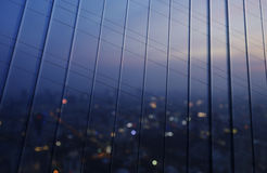 Reflection of blurred aerial view of cityscape on warm light sun Royalty Free Stock Images