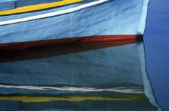 Reflection of a boat. A reflection of a fish boat in a river Royalty Free Stock Photo