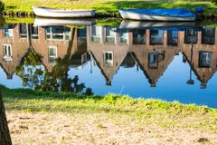 Row dutch houses, reflection in canal of Alkmaar, The Netherlands royalty free stock photography