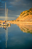 Reflection of Boats in Marina. Two Sailboats moored in Port Ginesta Marina, Castelldefels, Catalonia, Spain near Barcelona stock image