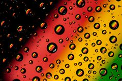 Reflection of Bolivia flag. In water droplets Stock Photography