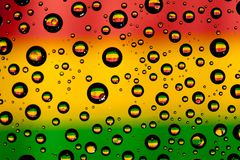 Reflection of Bolivia flag. In water droplets Royalty Free Stock Image