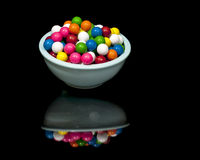 Bowl of gumballs and reflection Royalty Free Stock Photo