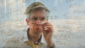 Reflection of a brainstorming businessman writing business words onto glass. Reflection of a brainstorming businessman brainstorming planning a solution writing stock video