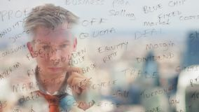 Reflection of a brainstorming businessman writing business words onto glass. Reflection of a brainstorming businessman writing business keywords onto glass with stock footage