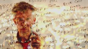 Reflection of a brainstorming businessman writing business words onto glass. Reflection of a brainstorming businessman writing business keywords onto glass at stock video