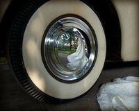 Reflection of bride. Wide white wall tire with reflection of bride Stock Photo