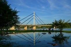 Reflection of bridge over Danube river flooded after the rains. Novi Sad, Serbia stock images