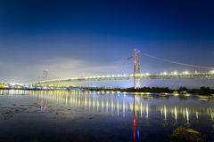 Reflection of a bridge in the sea at night stock photos