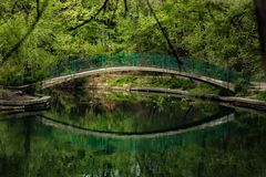 Reflection of the bridge in the water. National park Royalty Free Stock Image