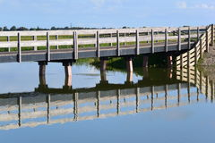 Reflection of bridge in water royalty free stock photo