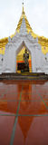 Reflection of Buddha statue and Chedi of Wat Phra That Chae Haen Stock Image