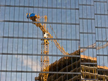 Reflection of building constru Stock Photo