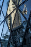 Reflection. A building and a crane reflect in another building Royalty Free Stock Photography