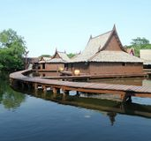 Reflection of building  of floating market in Thailand Stock Photo