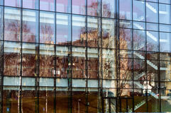 Reflection of building on the glass wall. Beautiful modern building in the city Royalty Free Stock Images