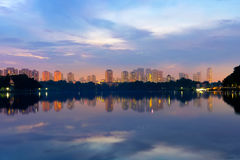 Reflection of building in the lake at sunrise at lakeside. Singa. Pore Stock Photos