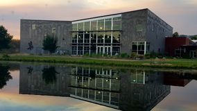 Reflection. A building reflecting into a pond at sunset Royalty Free Stock Photos