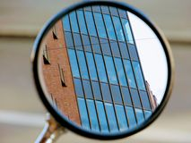 Reflection of building in small mirror Stock Photography