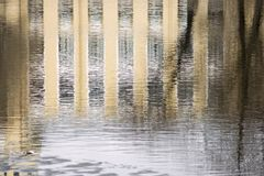 Reflection of the building in water ripples Royalty Free Stock Photo