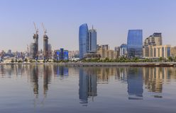 Reflection of buildings in the Caspian Sea in Baku. Nature royalty free stock images