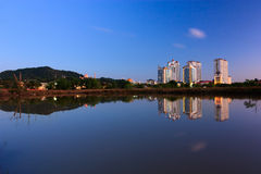 Reflection of buildings and hills at blue hour in Sabah, Borneo Stock Photo