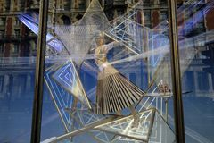 A window display showing a mannequin. Reflection of buildings on a shop window displaying a mannequin Stock Image