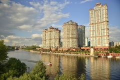 Reflection of buildings in water / red sails on the banks of the Moscow river. This kit is in Strogino in Moscow Stock Photo