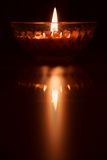 Reflection of burning candle Stock Photos